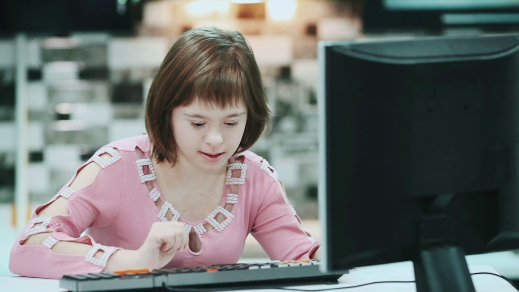 employee with down syndrome sitting at desk